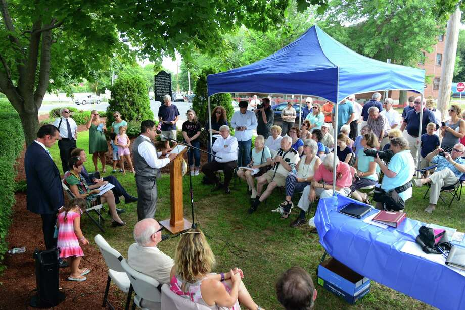 In this file photo, then Ansonia Mayor David Cassetti speaks at a program commemorating the 60th Anniversary for the Great Flood of 1955, which was held at Vartelas Park in Ansonia, Conn., on Wednesday Aug. 19, 2015. The park is named after the Vartelas family whose grocery store, which was destroyed in the flood along with the rest of the block. Members of the Vartelas family were present for the event. Photo: Christian Abraham / Hearst Connecticut Media / Connecticut Post