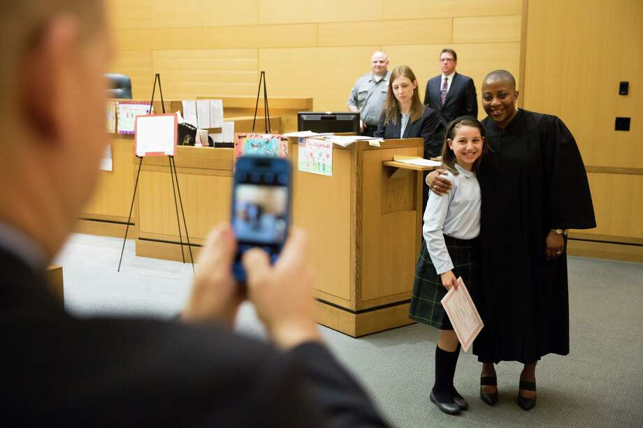 Julianna LaMagna poses with the Honorary Erika M. Tindill at the Fairfield County Bar Association's Law Day at the Stamford Superior Court on Friday, April 28, 2017. Photo: Chris Palermo / For Hearst Connecticut Media / Stamford Advocate Freelance