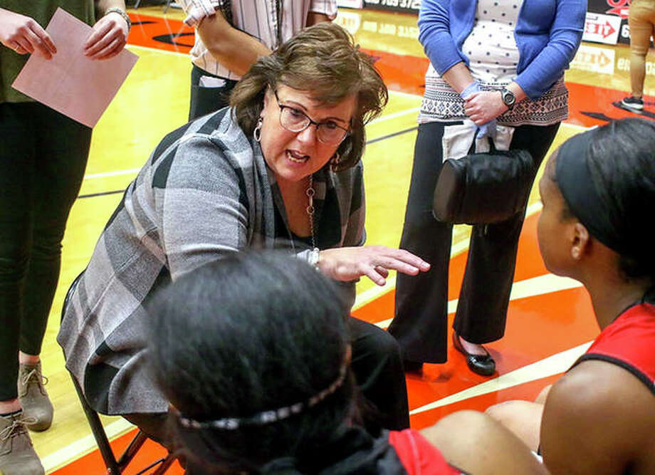 SIUE coach Paula Buscher talks to her Cougars during a timeout during a regular-season game at First Community Arena in Edwardsville. Photo: SIUE Athletics