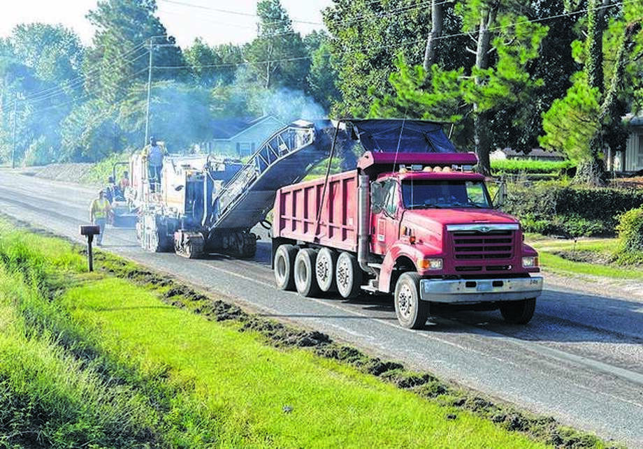 Scenes like this one could become common along Route 143 between Route 3 and Discovery Parkway this spring and summer as IDOT plans to begin a repaving project starting Wednesday through July. Photo: Hearst File Photo