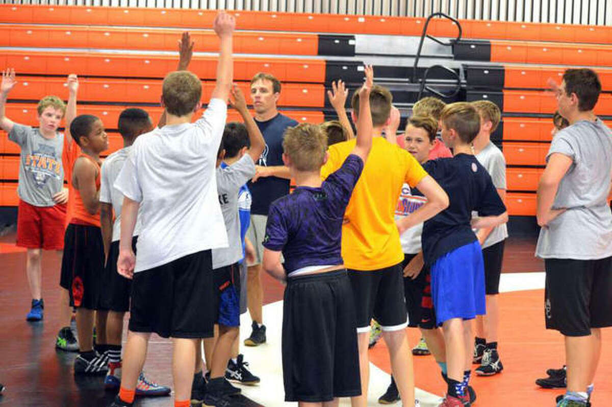EWC head coach Pat McNamara runs a camp last summer. He is currently doing online workouts on Facebook to help kids stay active during the stay-at-home order.