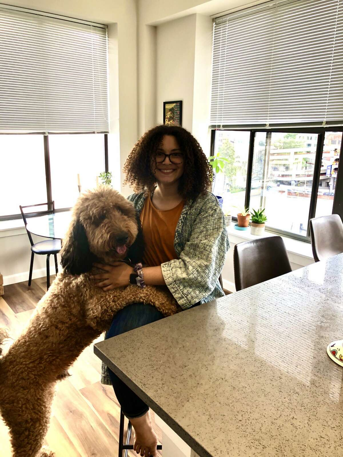 Nedra Erway and her goldendoodle, Murphy, in their apartment at The Knick in Albany.