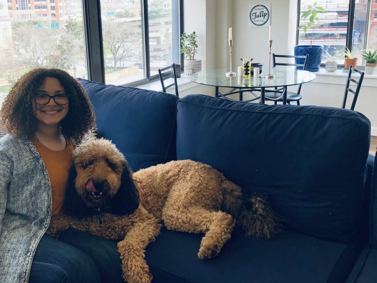 Nedra Erway and her dog, Murphy, at their apartment at The Knick in Albany.