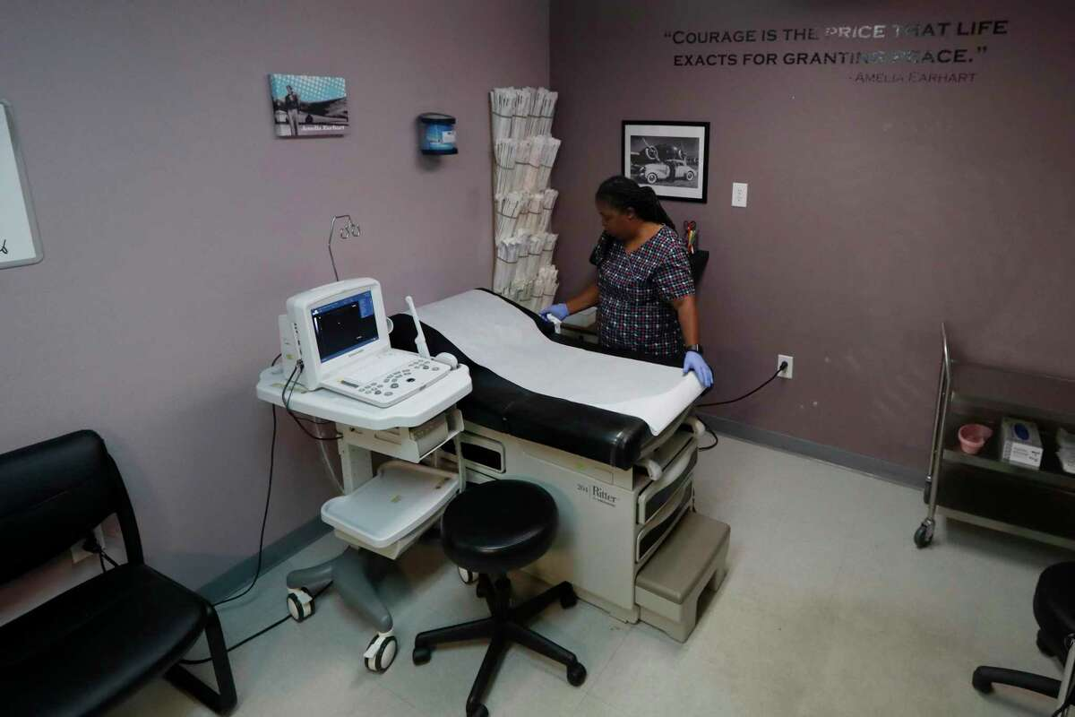 FILE - In this Sept. 4, 2019 file photo, Director of Clinical Services Marva Sadler, prepares the operating room at the Whole Woman's Health clinic in Fort Worth, Texas. On Tuesday, April 7, 2020, the 5th U.S. Circuit Court of Appeals held 2-1 that the state's restrictions on abortions could remain in place during the COVID-19 coronavirus pandemic. (AP Photo/Tony Gutierrez)