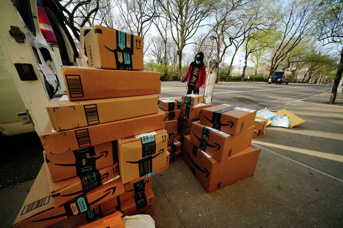 A person is seen delivering packages for Amazon prime during the coronavirus pandemic on April 7, 2020.