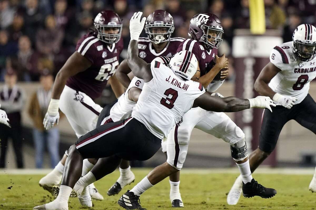South Carolina State's Javon Kinlaw (3) tackles Texas A&M quarterback Kellen Mond during the second quarter of an NCAA college football game Saturday, Nov. 16, 2019, in College Station, Texas. (AP Photo/David J. Phillip)