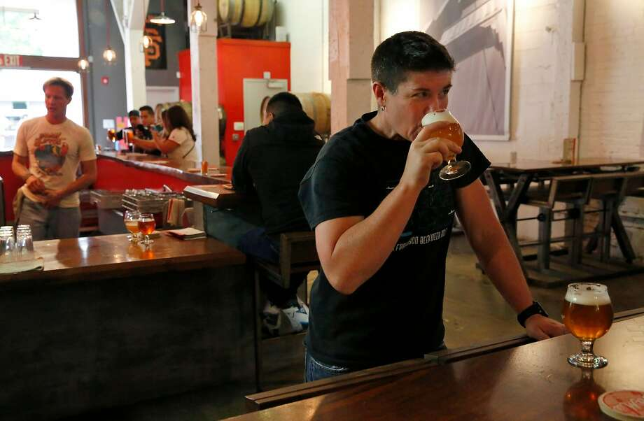 """Regan Long, owner of Local Brewing Co. in San Francisco, says that the spring and summer months are typically her busiest. """"We're never going to get that business back,"""" she says. Photo: Leah Millis / The Chronicle 2017"""