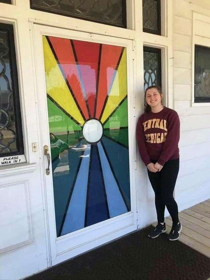 North Huron sophomore Brooke Gordon paints a beautiful design on the window of The Questover in Port Austin. (Shelli Gordon/ Courtesy)