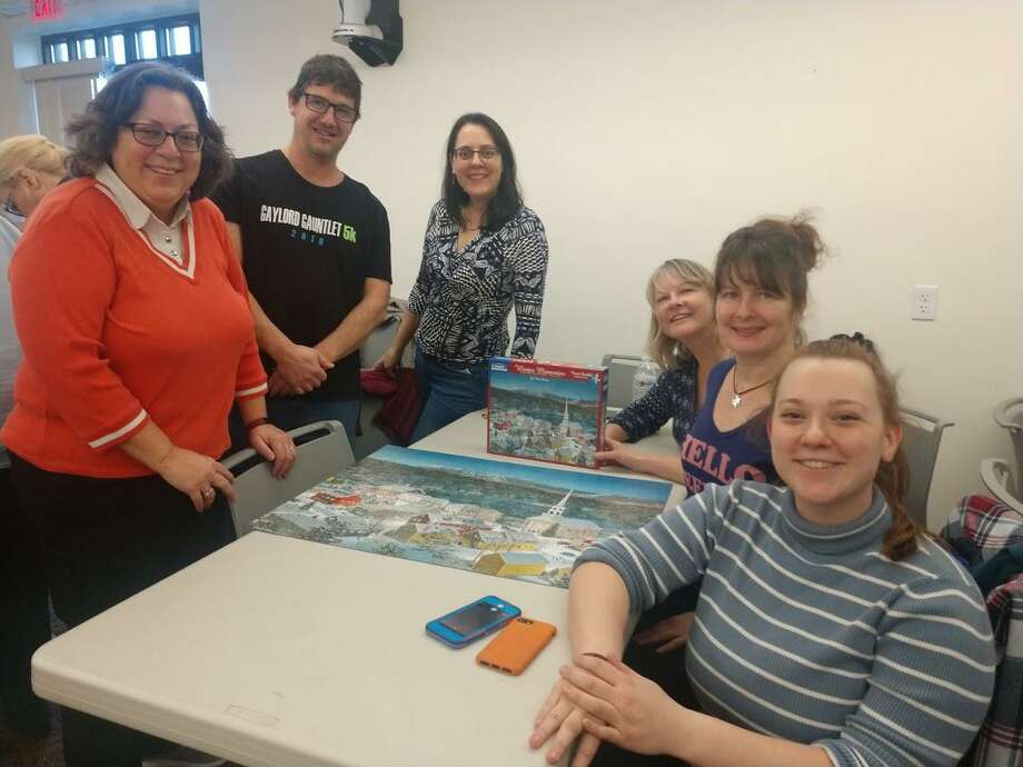 The North Haven Memorial Library had its first puzzle off of 2020 Jan. 11. The Puzzle Off started at 10:15 a.m. and was scheduled to end at 1:30 p.m. However, the winning team, Puzzle Free or Die, finished at 12:26 p.m. Photo: Contributed Photo