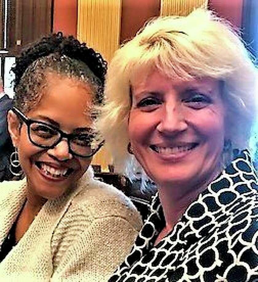 Rep. Karen Whitsett, D-Detroit, poses with Rep. Annette Glenn, R-Midland. (Photo provided)