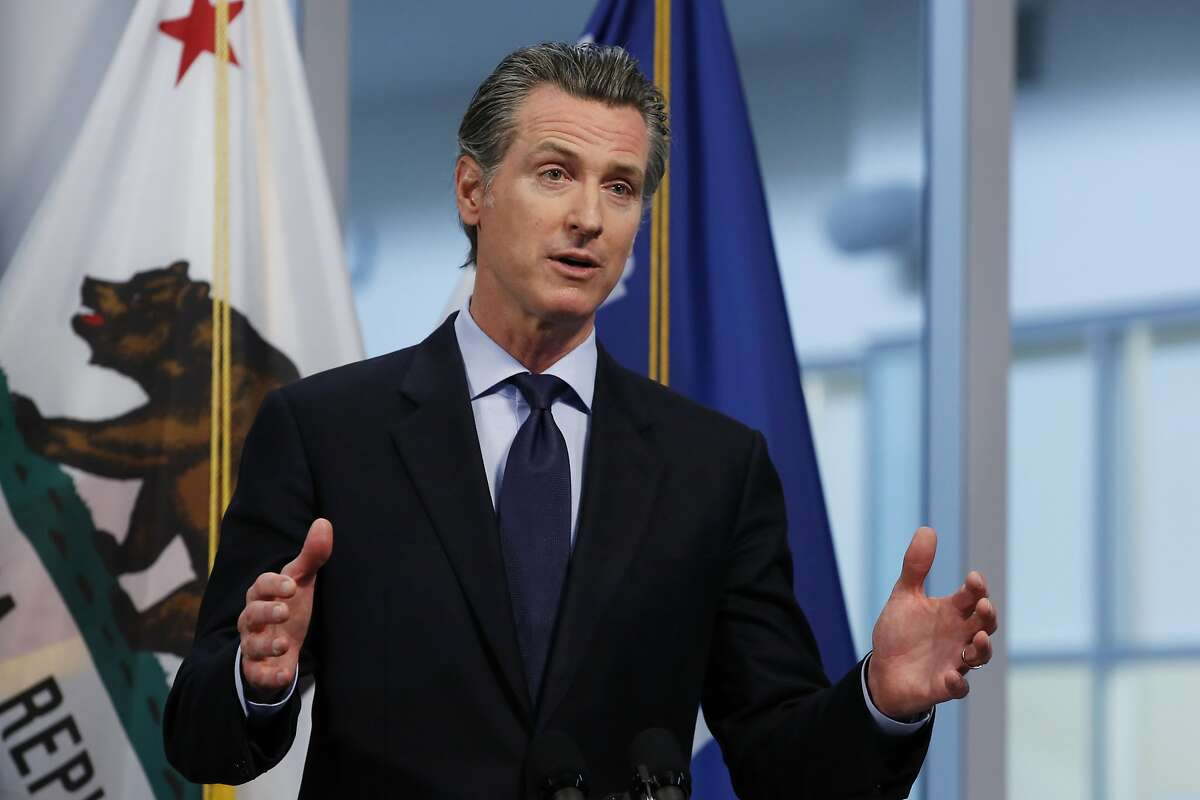 In this photo taken Thursday, April 9, 2020, Gov. Gavin Newsom gives his coronavirus update at the the Governor's Office of Emergency Services in Rancho Cordova, Calif. California public health officials said Friday, April 10, 2020, that the spread of the coronavirus in the state might not be as high as expected. Newsom said he was already making detailed plans on how to re-open the state while still stressing the need for people to say at home and stay away from others. (AP Photo/Rich Pedroncelli)