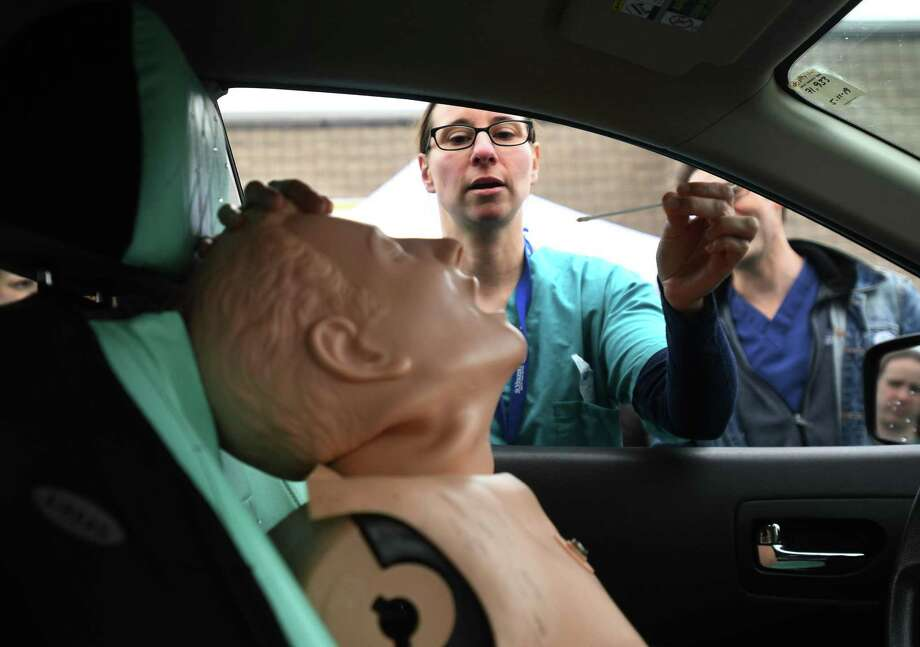 Nurse Michelle DiLorenzo, LPN, practices taking a nasal swab in preparation for drive through coronavirus testing at St. Vincent's Bridgeport Health & Wellness Center in Bridgeport, Conn. on Tuesday, March 17, 2020. Similar drive-through testing is also being done at PhysicianOne Urgent Care in Ridgefield. Photo: Brian A. Pounds / Hearst Connecticut Media / Connecticut Post