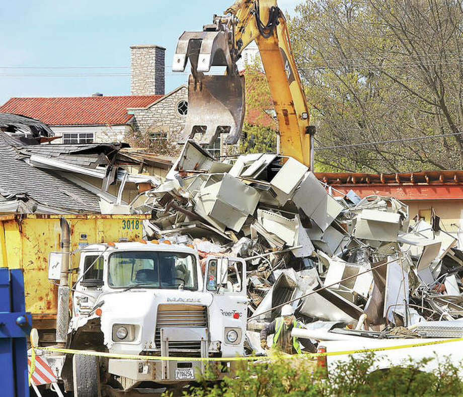 A trackhoe demolishing an older building on the SIU School of Dental Medicine campus on Tuesday stacks up metal desks and furniture to be hauled off. The work is part of groundbreaking for a new $11.5 million Advanced Care Clinic expected to be completed in June 2021.