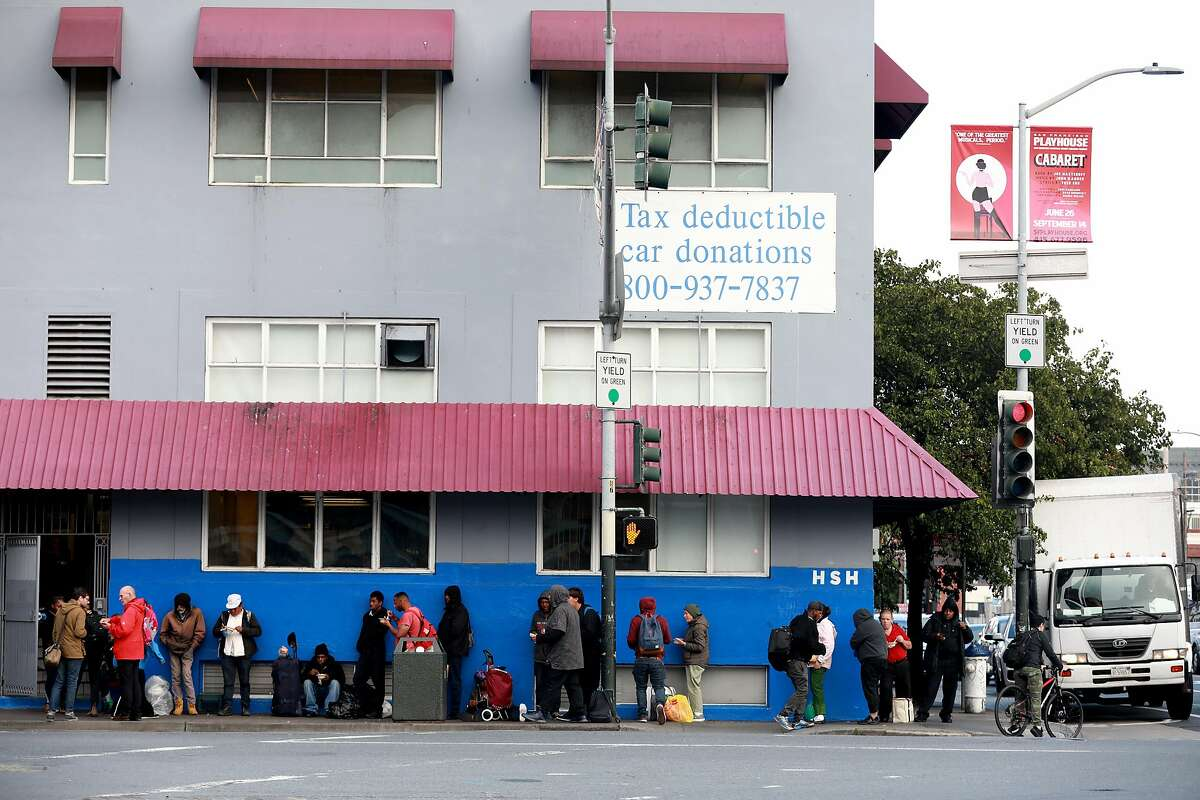Folks stand in line outside Multi-Service Center South, located at 525 5th St., as they seek shelter for the night in San Francisco, Calif., on Tuesday, June 18, 2019. Shot from the intersection of Fifth and Bryant at 6:45 PM, facing 525 5th St.