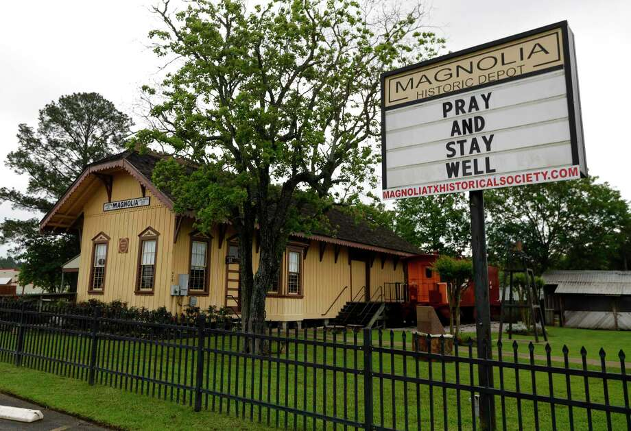 A sign at the Magnolia historic train depot encourages residents to pray and stay well. On Tuesday, the county logged 308 cases of COVID-19. Photo: Jason Fochtman, Houston Chronicle / Staff Photographer / 2020 © Houston Chronicle