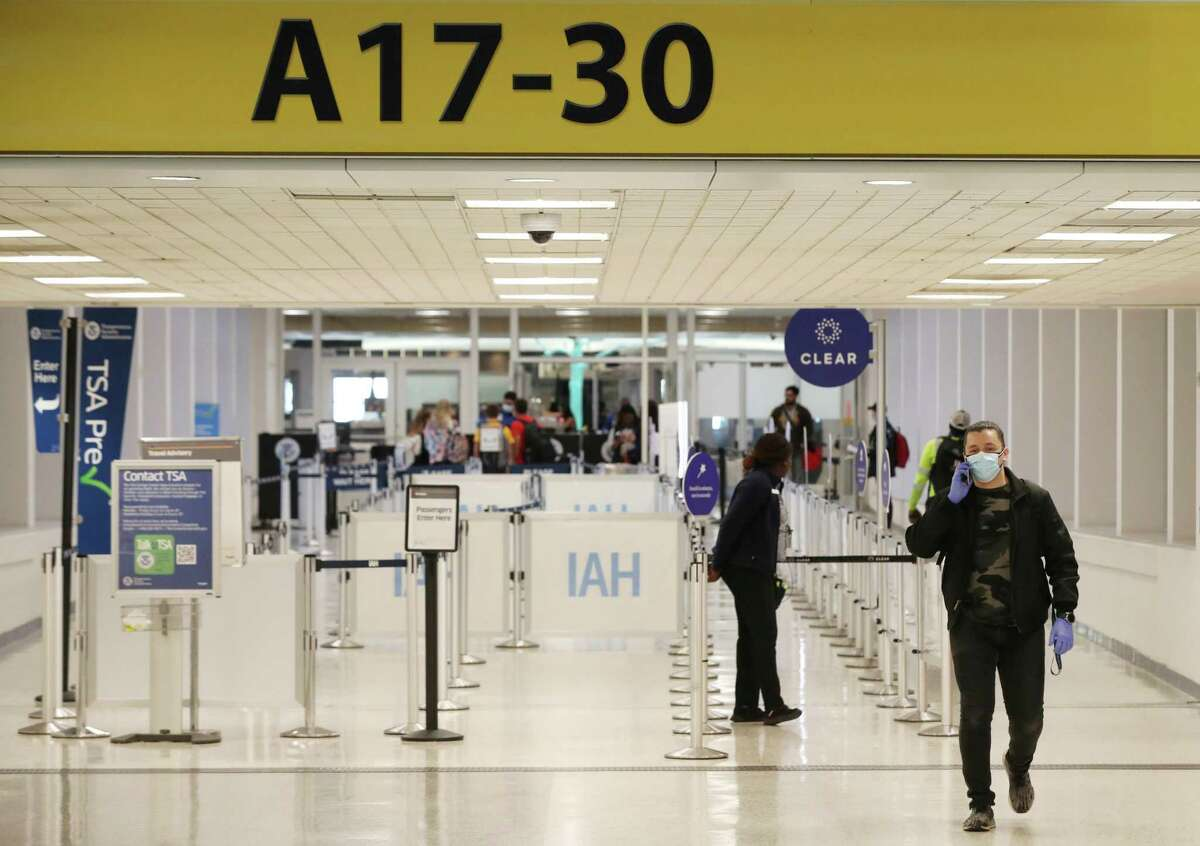 A man walks through Terminal A of Houston's Bush Intercontinental Airport on March 28, 2020. Traffic through airports nationwide has been down since stay-at-home orders in most states.
