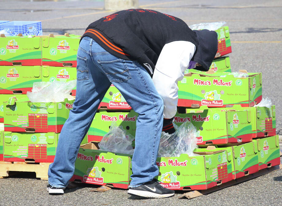 The Caseville Community Food Pantry teamed up with the Food Bank of Eastern Michigan to host a 'pop-up' food pantry on Tuesday. The distribution took place at the Caseville Public School parking lot. Photo: Mark Birdsall/Huron Daily Tribune