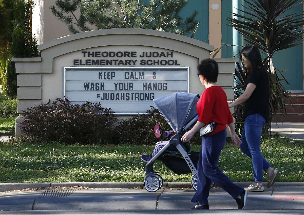 A reminder for people to wash their hands is displayed on a sign outside Theodore Judah Elementary School in Sacramento, Calif., Wednesday, April 1, 2020. Gov. Gavin Newsom announced, Wednesday, that California schools will likely remain closed for the rest of the school year, but provide off-site education due to coronavirus pandemic. (AP Photo/Rich Pedroncelli)