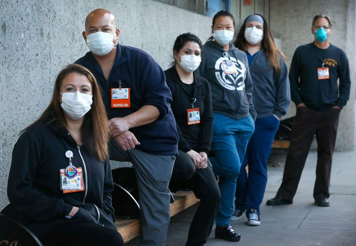 Shami Engel (left) gathers with colleagues outside of the psychiatric emergency department where they work as registered nurses in San Francisco, Calif. on Tuesday, April 14, 2020. With Engel is, from left, Michael Roxas, Nancy Gudino, Charlene Leung, Leticia Ornelas and Brian Saxon. The nurses may have been exposed to the COVID-19 coronavirus after a patient was brought into the ward on Saturday.