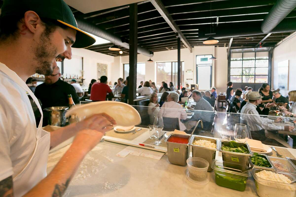 Dan Damone makes pizza at A16 restaurant in Oakland, Calif., on Wednesday, July 25th, 2013.