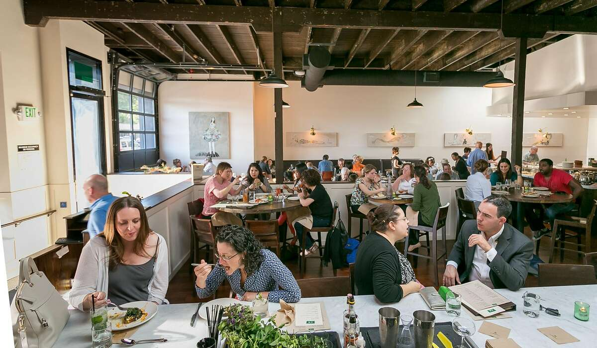 Diners enjoy dinner at A16 restaurant in Oakland, Calif., on Wednesday, July 25th, 2013.