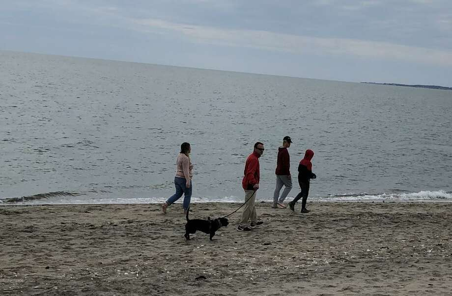 A family at Hammonasset Beach State Park last Sunday. Photo: Jennifer Kaylin / Contributed Photo
