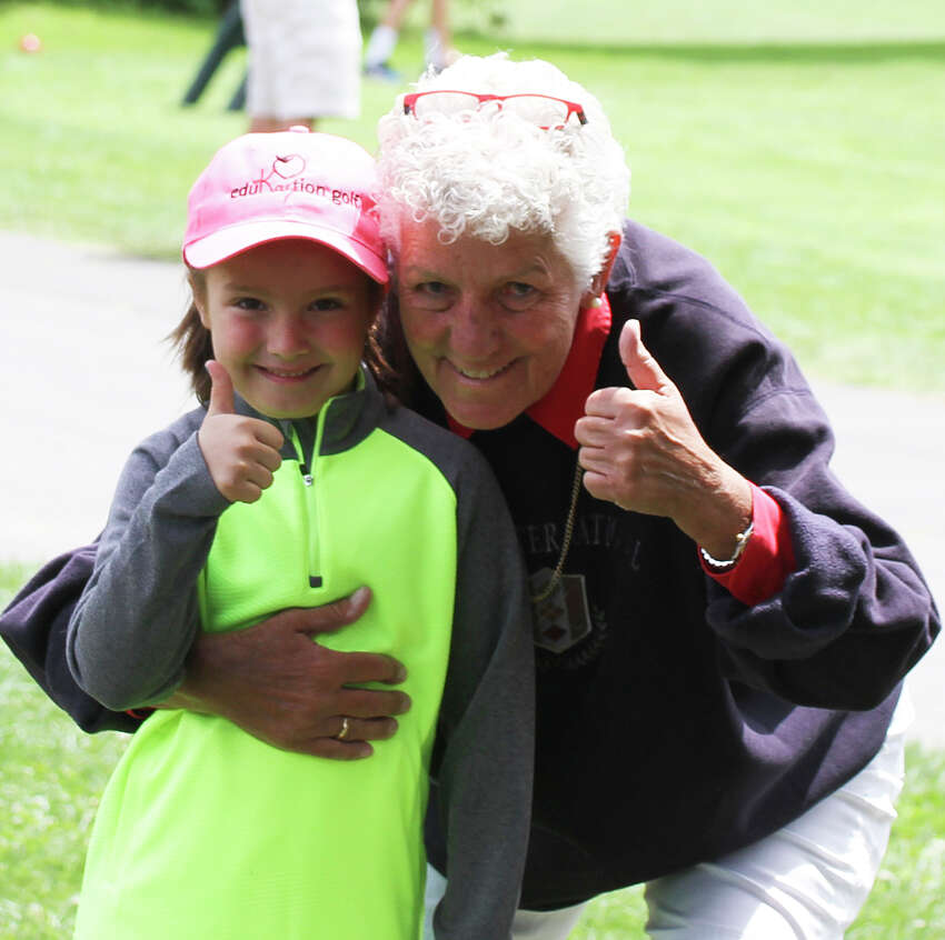 PGA/LPGA Professional Kay McMahon with her young student Maria Glavin, 7, of Waterford. Maria started taking lessons from McMahon when she was 4 years old.