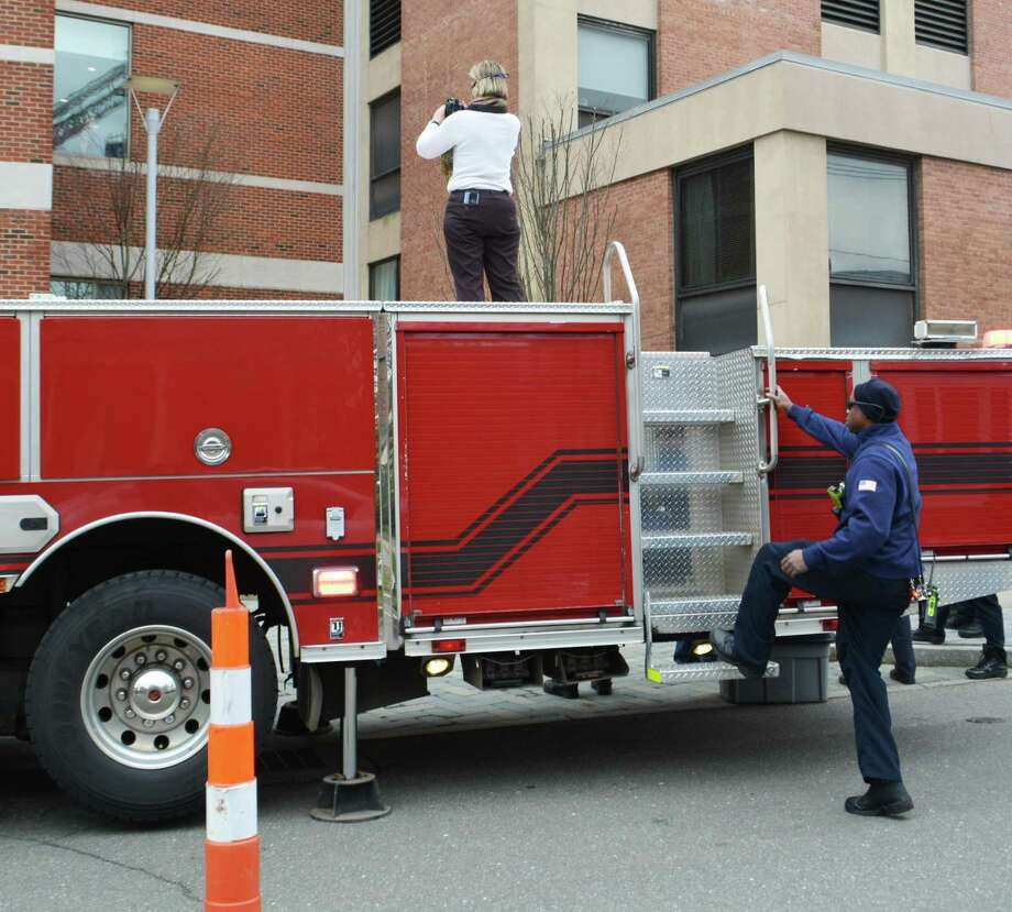 """Middletown firefighters from the downtown, Cross Street, South Fire District and Westfield stations held a truck parade """"sneak attack"""" to thank the doctors, nurses and other emergency personnel at Middlesex Hospital Tuesday afternoon. Photo: Cassandra Day / Hearst Connecticut Media"""