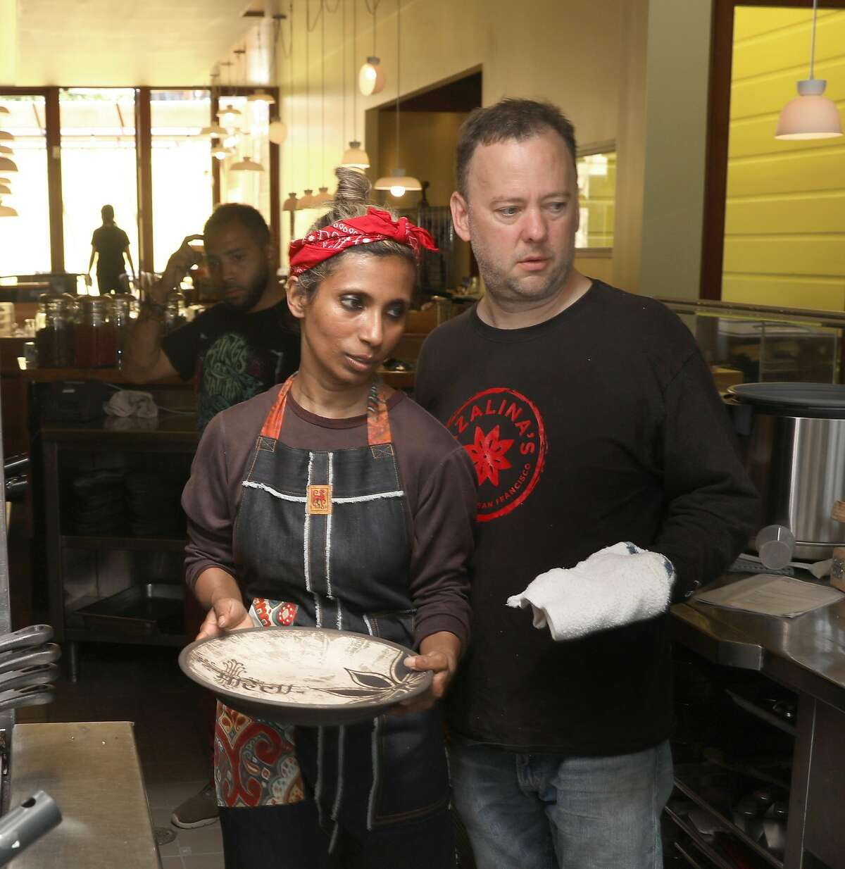 Owner/creator Azalina Eusope (left) with her business partner Tim Benson (right) as they test out pans and plates at Mahila on Wednesday, June 12, 2019 in San Francisco, Calif. Mahila, the first full-service Mamak (Indian Muslim) restaurant to ever open in San Francisco.
