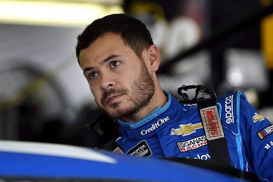 FILE - In this July 27, 2019, file photo, Kyle Larson climbs into his car for a practice session for the NASCAR Cup Series auto race in Long Pond, Pa. Kyle Larson was fired Tuesday, April 14, 2020, by Chip Ganassi Racing, a day after nearly every one of his sponsors dropped the star driver for using a racial slur during a live stream of a virtual race. Larson, in his seventh Cup season with Ganassi and considered the top free agent in NASCAR mere weeks ago, is now stunningly out of a job in what could ultimately be an eight-figure blunder by the star. (AP Photo/Derik Hamilton, File) Photo: Derik Hamilton, Associated Press