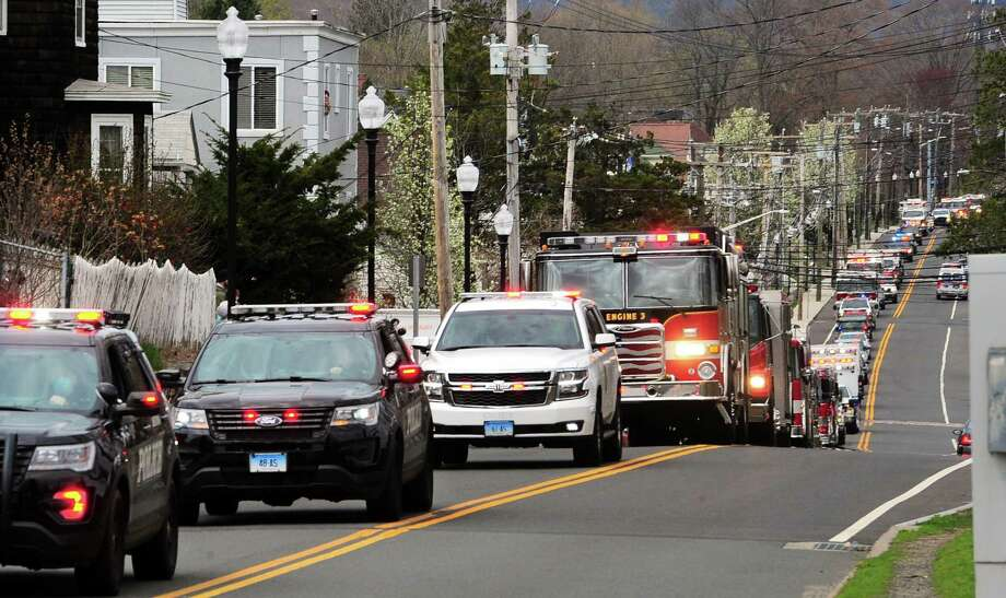 FILE PHOTO: In this file photo, dozens of first responder vehicles line Wakelee Avenue to Griffin Hospital in Derby, Conn., on Tuesday, April 14, 2020, as part of a parade in support of health care workers. Photo: Christian Abraham / Hearst Connecticut Media / Connecticut Post