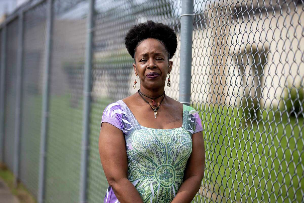 Catherine Gay poses for a portrait outside of the Montgomery County jail in Conroe, Tuesday, April 7, 2020. The women fear that not enough is being done to prevent the spread of COVID-19 in the jail system.