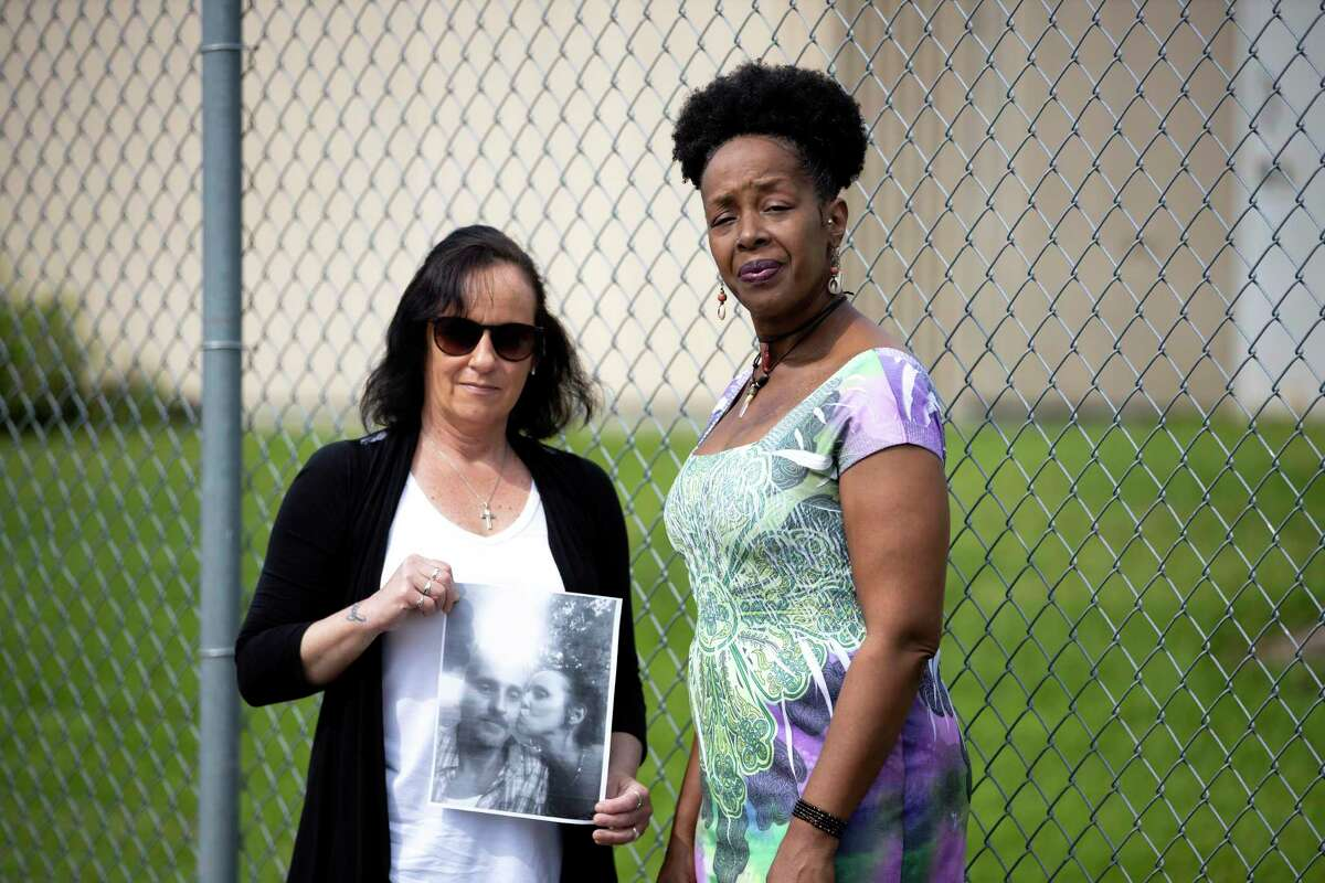 Tracey Schneider (left) and Catherine Gay pose for a portrait outside of the Montgomery County jail in Conroe, Tuesday, April 7, 2020. The women fear that not enough is being done to prevent the spread of COVID-19 in the jail system.