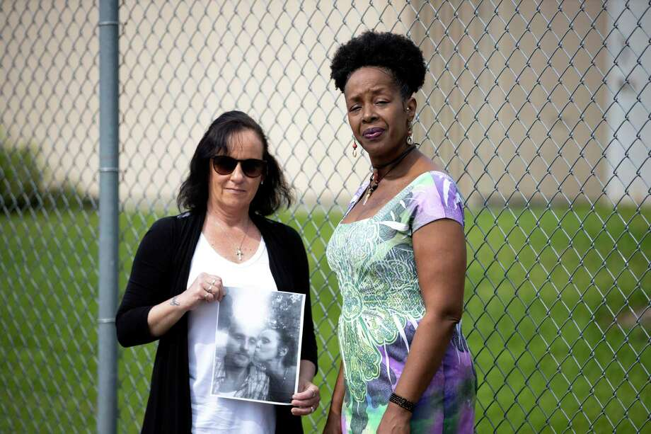 Tracey Schneider (left) and Catherine Gay pose for a portrait outside of the Montgomery County jail in Conroe, Tuesday, April 7, 2020. The women fear that not enough is being done to prevent the spread of COVID-19 in the jail system. Photo: Gustavo Huerta, Houston Chronicle / Staff Photographer / Houston Chronicle © 2020