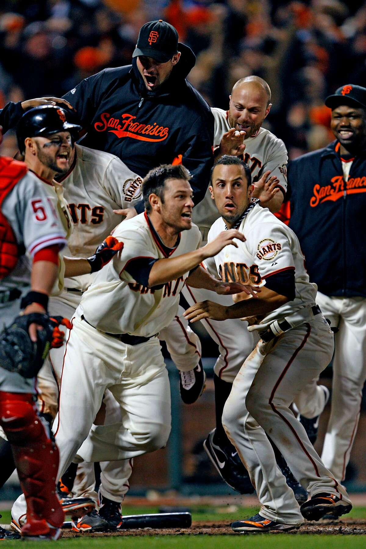 Giants players including Freddy Sanchez (center) celebrated the Giants victory. San Francisco Giants defeated the Philadelphia Phillies 6-5 on October 20, 2010 at AT&T park.