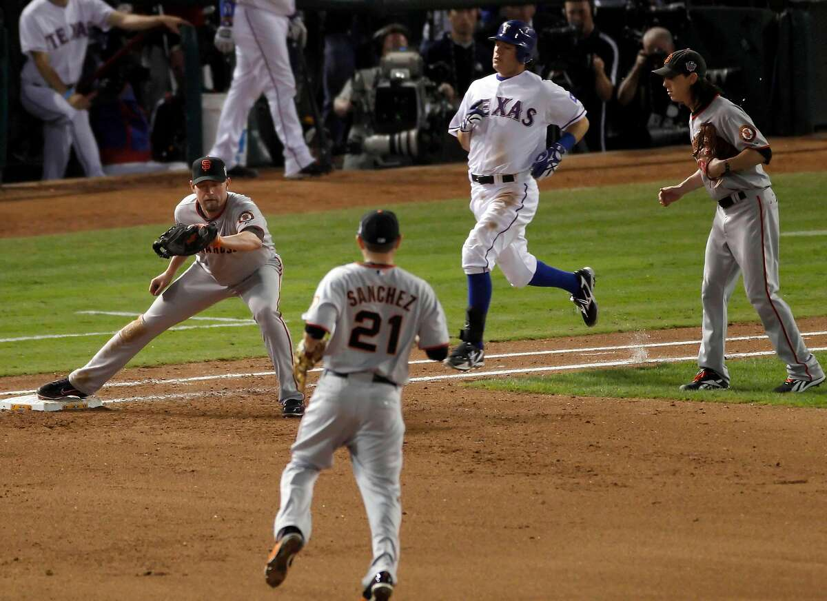 Texas Rangers second baseman Ian Kinsler (5) is out at first as Aubrey Huff catches a throw from Freddy Sanchez in the fifth inning during game 5 of the 2010 World Series between the San Francisco Giants and the Texas Rangers on Monday, Nov. 1, 2010 in Arlington, Tx.