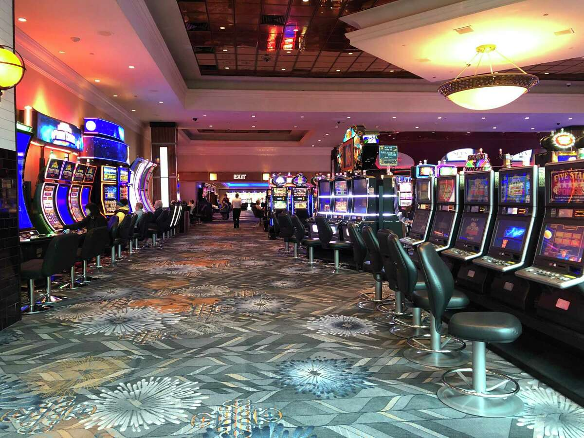 Parts of Foxwoods Resort Casino were nearly empty on Monday, and although slots and live table games in some areas remained open, many stores and restaurants were closed. The casino, run by the Mashantucket Pequot Tribe, and Mohegan Sun, run by the Mohegan Tribe, will close to the public for two weeks starting Tuesday, March 17 at 8 p.m. Neither casino has ever closed to the public before since they opened more than 20 years ago.