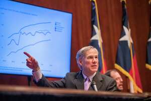 Texas Gov. Greg Abbott expressed optimism during a coronavirus news conference, Friday, April 10, 2020, in Austin, Texas. Abbott also said the state's death toll was lower than many other states. (Ricardo B. Brazziell/Austin American-Statesman via AP)
