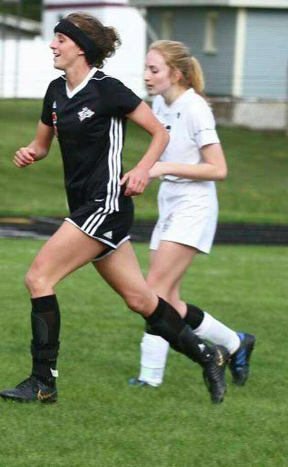 Reed City's Taylor Harrison (left) was in her fourth year of soccer. (Pioneer file photo)