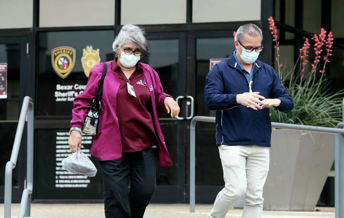 Medical personnel leave after using hand sanitizer at the Bexar County Sheriff's Office and Detention Center on April 14, 2020.