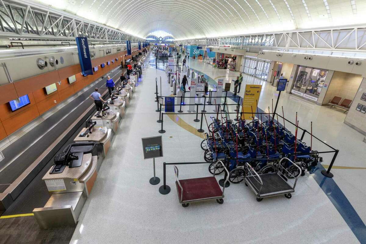 Terminal A at the San Antonio International Airport is virtually empty March 25 as air travel grinds to a halt due to the COVID-19 pandemic.