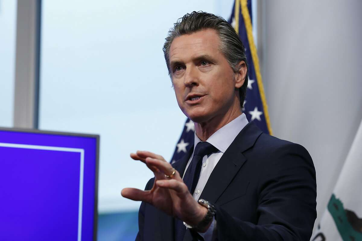 """California Gov. Gavin Newsom discusses an outline for what it will take to lift coronavirus restrictions during a news conference at the Governor's Office of Emergency Services in Rancho Cordova, Calif., Tuesday, April 14, 2020. Newsom said he won't loosen the state's mandatory stay-at-home order until hospitalizations, particularly those in intensive care units, """"flatten and start to decline.""""(AP Photo/Rich Pedroncelli, Pool)"""