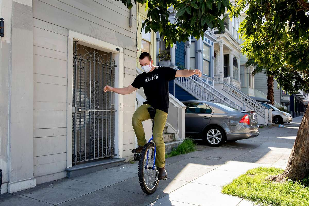 Eric Schmidt rides his unicycle through his Mission district neighborhood in San Francisco, Calif. Friday, April 10, 2020. As a way to entertain himself through the shelter-in-place order, Schmidt has started unicycling around the city. He says great way to exercise while keeping social distance because people won't come near you since they're convinced you'll fall on them.