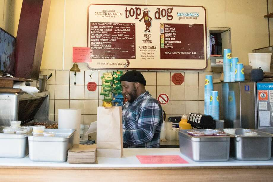 Tony Robinson grills a sausage for an order. Top Dog, a Berkeley food institution, has stayed open with take out orders during the Covid-19 shelter-in-place order in Berkeley, Calif. on April 14, 2020. Photo: Douglas Zimmerman/SFGate / SFGate