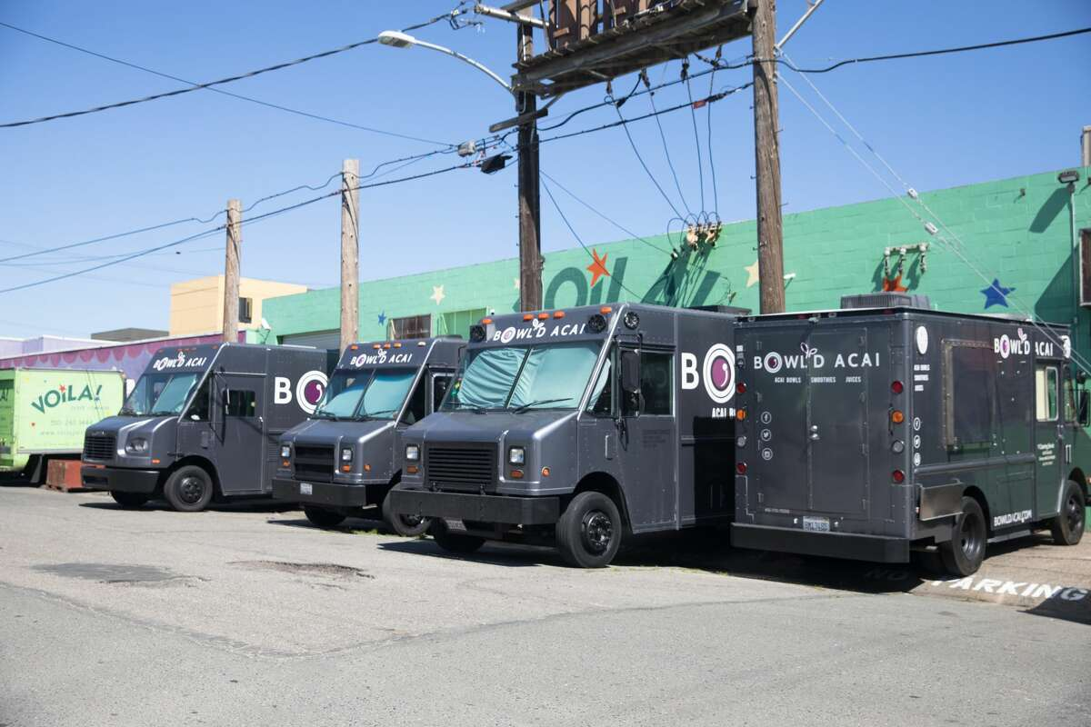 Bowl'€™d Acai food trucks prepare to head out for customers in Oakland.