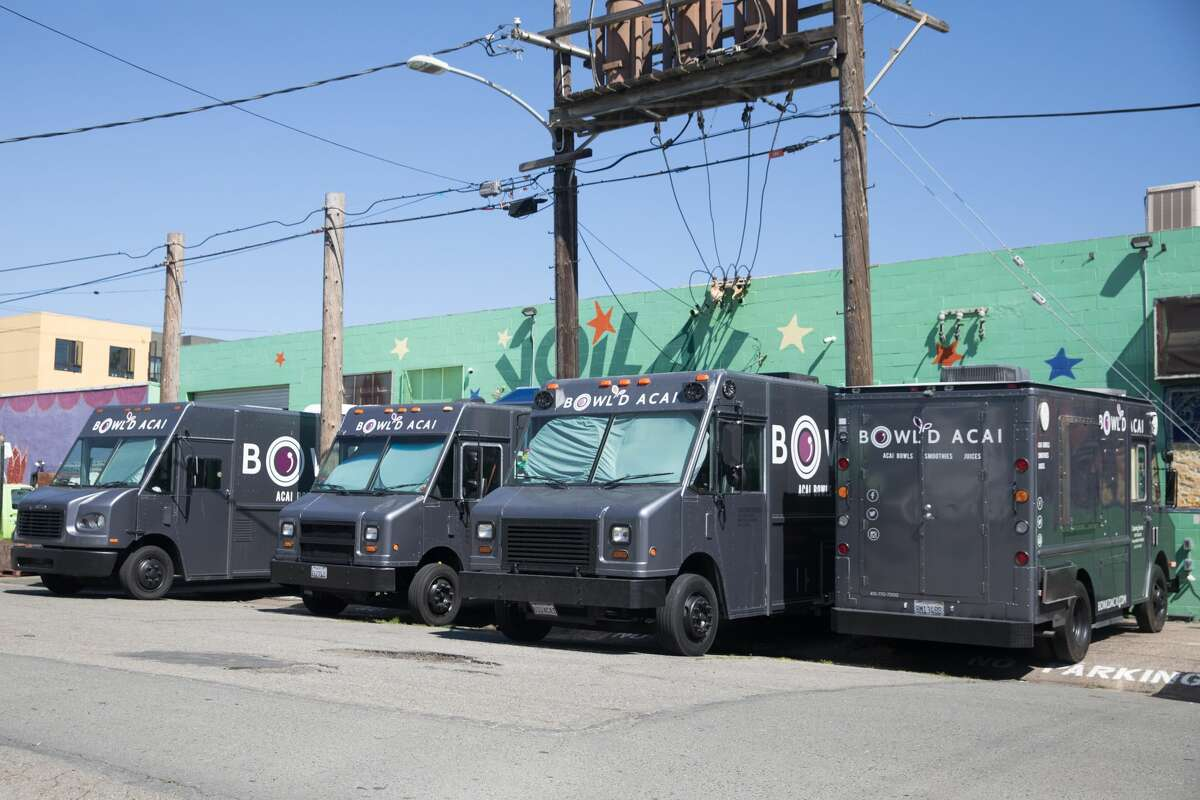 Four Bowl'd Acai food trucks sit unused because of a lack of demand due to shelter-in-place order to combat the spread of the COVID-19in Oakland, Calif. on April 14, 2020.