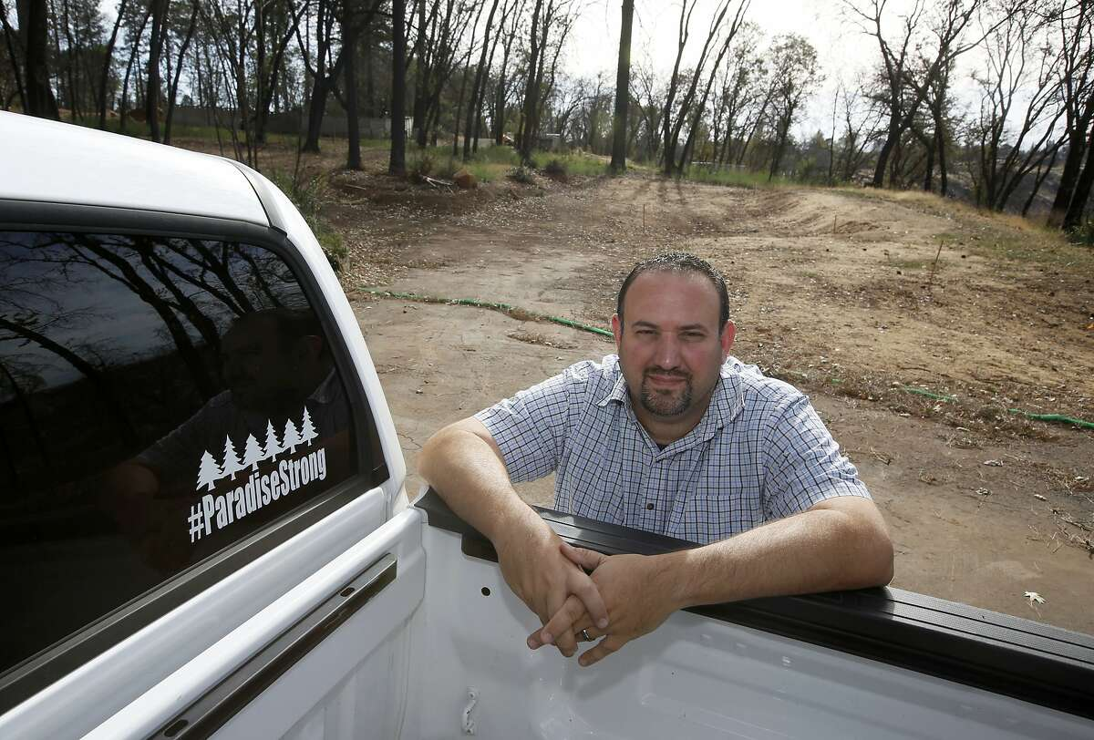 In this Thursday, Oct. 24, 2019, photo, Paradise city councilman Michael Zuccolillo poses at the lot where his home once stood before it was destroyed by last year's Camp Fire in Paradise, Calif. Zuccolillo, recently elected as vice-mayor by his fellow city council members, was arrested April 14, 2020 by the Butte County Sheriff. Zuccolillo has been arrested for sending sexually explicit text messages to a person pretending to be a 16-year-old girl, sheriff's officials announced Tuesday.