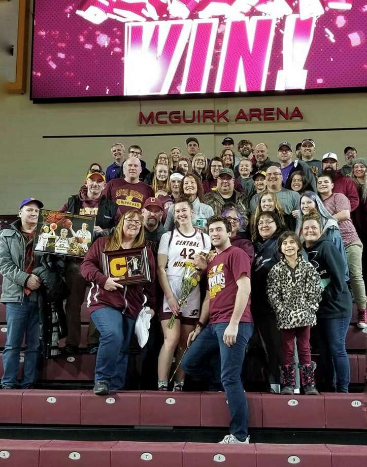 Mackenna Kelly celebrates her Central Michigan University senior night with family and a number of Frankfort community members who came out to support her. (Submitted photo)