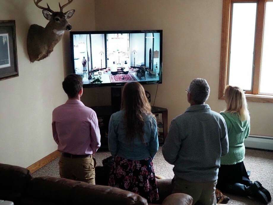(ABOVE RIGHT) In accordance to the quarantine procedures, the Kelly household celebrates Easter virtually with their extended family. (Submitted photo) (RIGHT) The Huddleston family attends Easter Mass through virtual means. (Submitted photo)