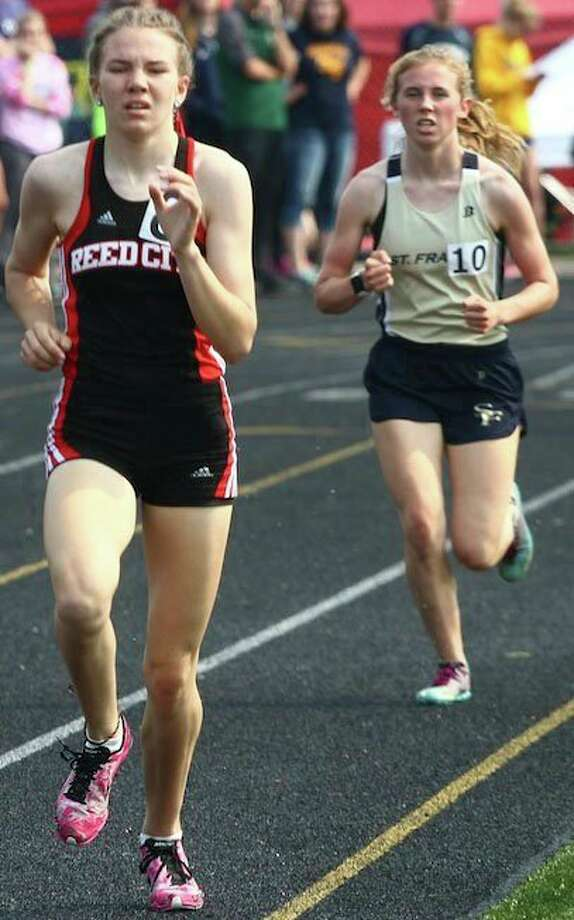 Reed City's Abbigail Kiaunis (left) has been among the area's top distance runners. (Herald Review file photo)